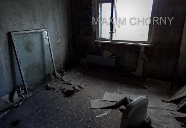 Inside abandoned living room in one of the Pripyat former apartments