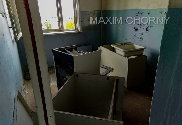 Inside abandoned kitchen in one of the Pripyat former apartments