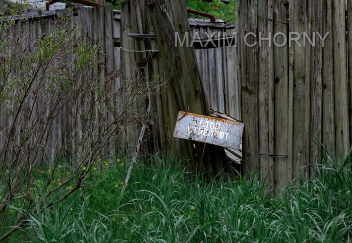 Caution sign on the fence of the Chernobyl-2 perimeter