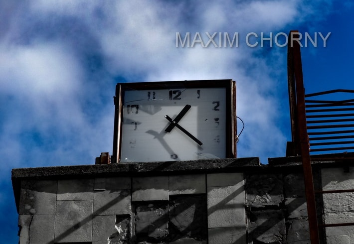 Big clock at the roof of Lazurny Pripyat swimming tool