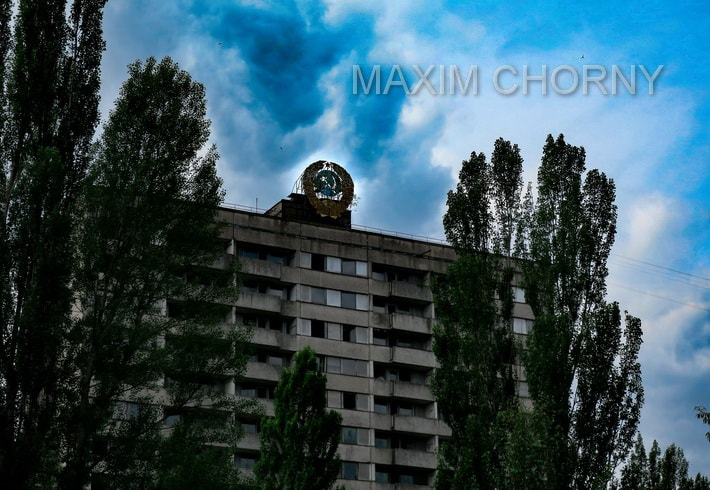 "Famous Pripyat 16-storey building with giant ""Hummer and Sickle"" symbol"