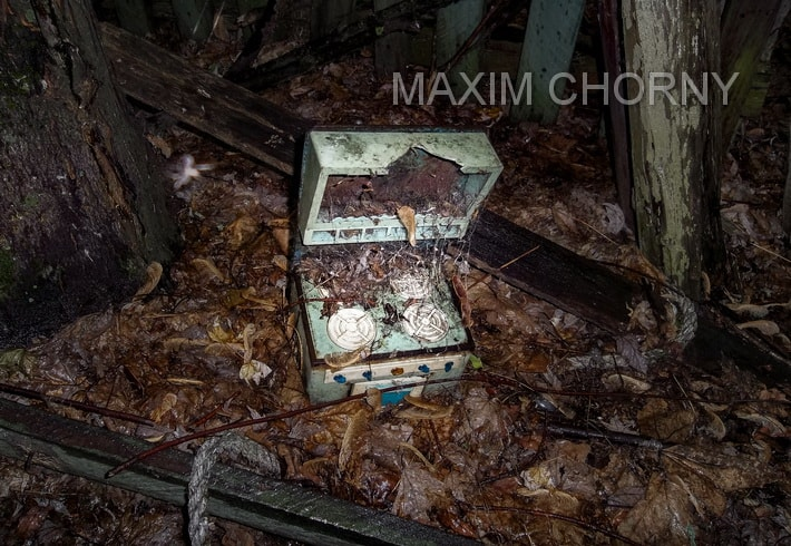 Creepy Chernobyl photo of a toy near the former kinder-garden in burried Kopachi village