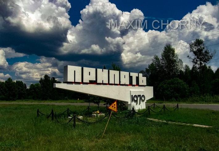 Pripyat sign and radiation symbol near the road to Pripyat