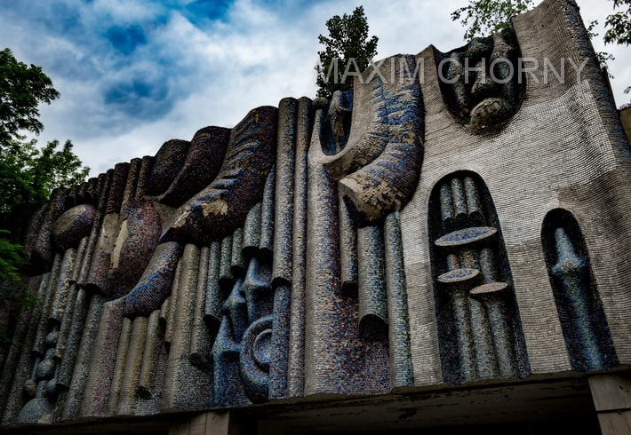 "Front face of the ""Prometey"" cinema in Pripyat covered with mosaic composition, called ""Energy"""
