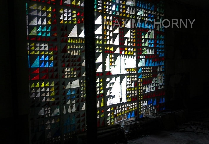 Inside former Prometey cinema - big stained-glass window still remains unruined