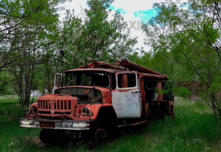 Abandoned transport near the cooling pond in Chernobyl
