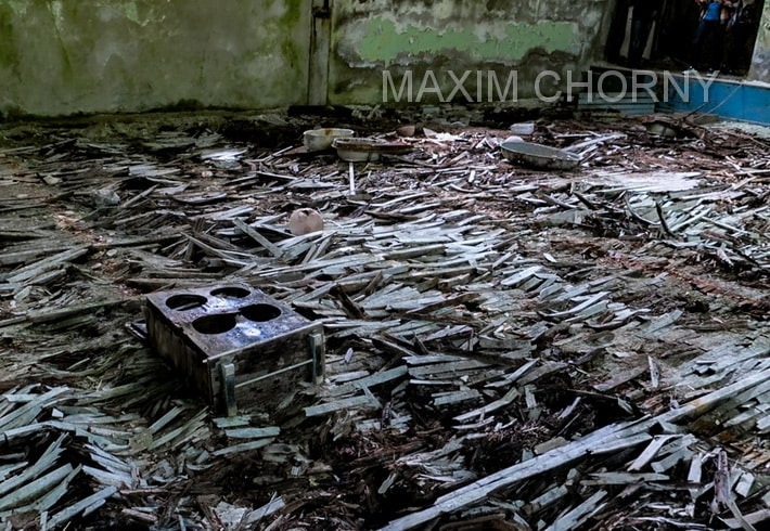 Creepy sports hall with rotten wooden floor in School № 2