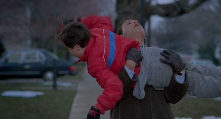 Phil Connors saves a boy falling out of the tree